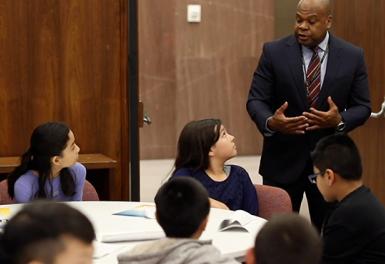 Facilitator speaking to students.